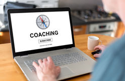 Coaching concept on a laptop. Man using a laptop with coaching concept on the screen Royalty Free Stock Photos
