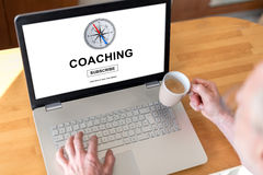 Coaching concept on a laptop. Man using a laptop with coaching concept on the screen Stock Image
