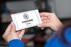 Coaching concept on a smartphone. Smartphone screen displaying a coaching concept royalty free stock photography