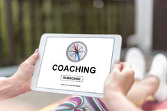 Coaching concept on a tablet. Female hands holding a tablet with coaching concept Royalty Free Stock Image