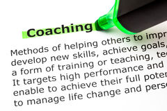 Coaching Definition. Definition of the word Coaching, highlighted with green text marker royalty free stock images
