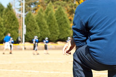 Coaching Little League Football Stock Image