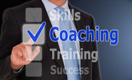 Coaching - Manager with touchscreen button. And text Stock Photography