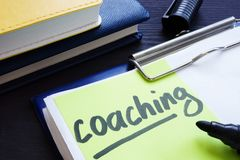Coaching and mentoring. Clipboard with learning papers. Coaching and mentoring concept. Clipboard with learning papers stock photo