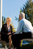 Coaching outdoors. A men and a women have a coaching discussion Stock Photography