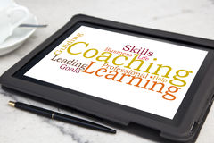 Coaching. Tablet with personal coaching word cloud Stock Photos