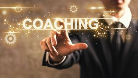 Coaching text with businessman. On dark vintage background royalty free stock photo
