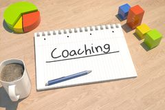Coaching text concept. Coaching - text concept with notebook, coffee mug, bar graph and pie chart on wooden background - 3d render illustration Stock Photography