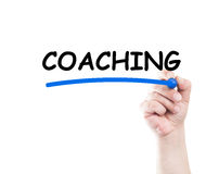 Coaching text underlined by hand with marker Stock Photo
