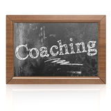 Coaching text written on blackboard Stock Photo