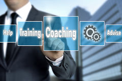 Coaching touchscreen is operated by businessman Stock Image