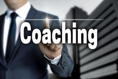 Coaching touchscreen is operated by businessman.  Royalty Free Stock Photos