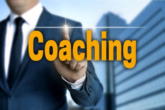 Coaching touchscreen is operated by businessman.  Royalty Free Stock Image