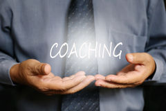 Coaching word on hand Royalty Free Stock Photography