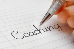 Coaching word handwriting stock images