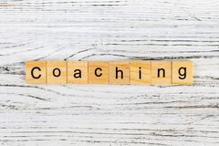 Coaching word made with wooden blocks concept royalty free stock photos