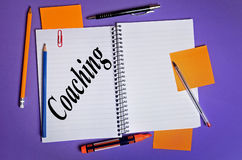 Coaching word. Written on notepad royalty free stock image