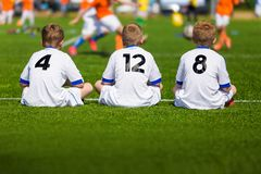 Coaching Youth Soccer. Young Boys Sitting on Football Field. And Watching Tournament Game. Football Match for Kids Royalty Free Stock Photos