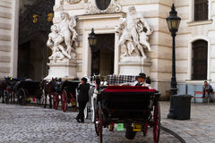 Coachman in the brougham near the Hofburg palace. Stock Images