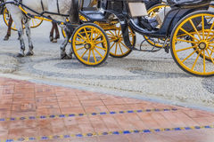 Coachman resting at Plaza de Espana in Seville, Spain. Coachman resting on his carriage at Plaza de Espana in Seville, Andalusia, Spain stock images