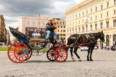 Coachman sits on a carriage. Rome, Italy Stock Images