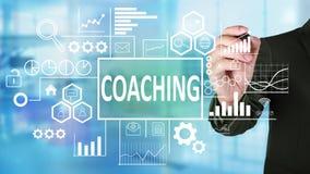 Coachning i affärsidé arkivbilder