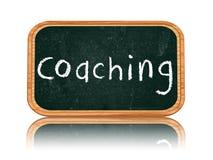 Coachning på blackboardbaner royaltyfri foto