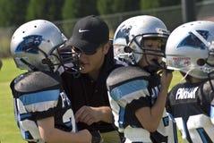 coachningfotbollliga little Arkivfoton