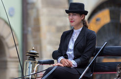 Coachwoman carriages cab rides- Cracow, Poland Royalty Free Stock Images