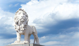 Coade Stone Lion on Westminster Bridge. Against dramatic sky royalty free stock images
