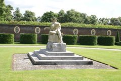 Coade stone statue in a topiary formal garden Royalty Free Stock Images