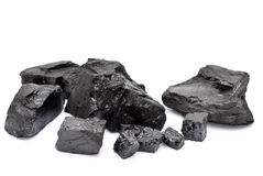 Coal. Pieces of black coal isolated on white background Stock Photos