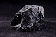 Coal. Is a natural dark brown to black graphitelike material used as a fuel, formed from fossilized plants Stock Photo