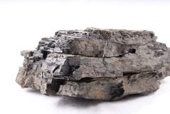 Coal. Is a natural dark brown to black graphitelike material used as a fuel, formed from fossilized plants Royalty Free Stock Photography