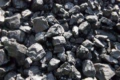 Coal. Mass of bituminous coal in the sun Stock Photos