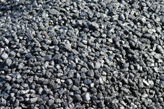 Coal Background. A background of black smokeless coal nuggets ready to be burnt as fossil fuel Stock Image