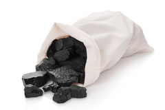 Coal in a bag. On a white background royalty free stock image