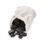 Coal in a bag. On a white background stock photos