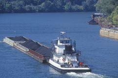 Coal barge on the Kanawha River in Charleston, West Virginia royalty free stock photo