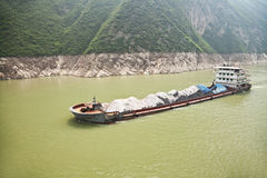Coal barge sailing along the Yangtze river in Stock Images