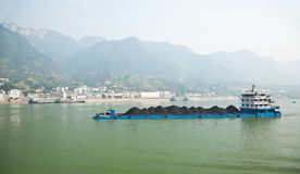 Coal barge sailing along the Yangtze river in Royalty Free Stock Photo
