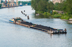 Coal barge sailing on the river Royalty Free Stock Photography