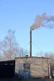 Coal boiler room with the smoking pipe. Kaliningrad region, Russ Royalty Free Stock Photo