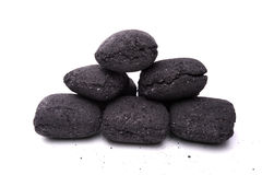 Coal briquette for BBQ Stock Images