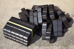 Coal briquette, coal briquette block, coal briquette blocks, pile of coal briquettes, piece coal briquettes blocks, black briquett Stock Image