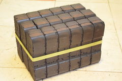 Coal briquette, coal briquette block, coal briquette blocks, pile of coal briquettes, piece coal briquettes blocks, black briquett Royalty Free Stock Images