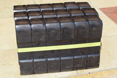 Coal briquette, coal briquette block, coal briquette blocks, pile of coal briquettes, piece coal briquettes blocks, black briquett Stock Image