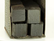 Coal briquettes into old carrier Stock Image