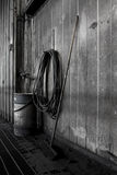 Coal broom. Old broom, hose, and barrel inside of coal power plant Royalty Free Stock Photo