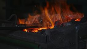 Coal with burning fire and iron stock footage